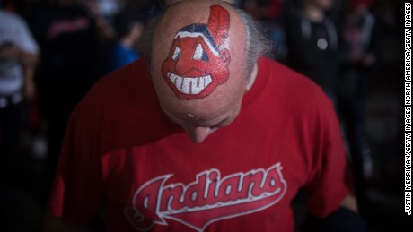 A Cleveland Indians fan with Chief Wahoo painted on his head stands outside the city's  Progressive Field before Game 6 of the World Series.