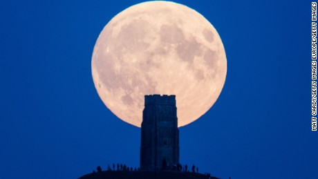 A supermoon rises behind Glastonbury Tor in September  2015 in Glastonbury, England.