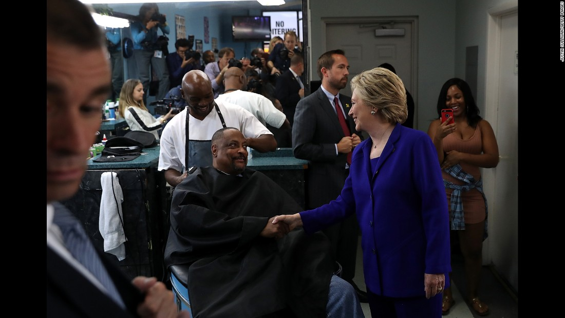 Clinton greets customers at a barbershop in North Las Vegas on November 2.
