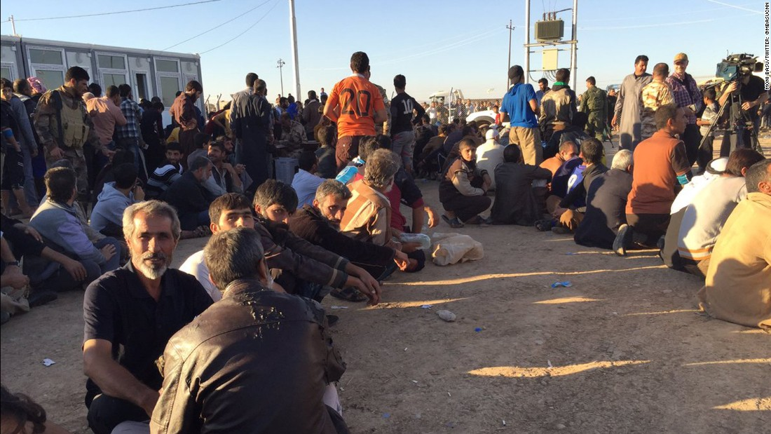 At one camp, where thousands from Mosul arrived Thursday, men and boys waited to be processed.