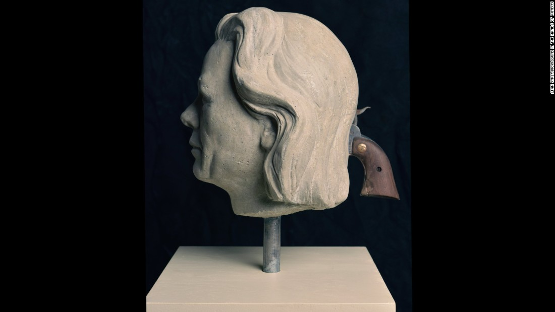 "North Carolina-based artist Mel Chin created two classical portrait busts of a man and a woman, composites of infamous killers, with muzzles for eyes. ""To lock eyes with these portraits is to stare straight into the dark barrels of guns."""