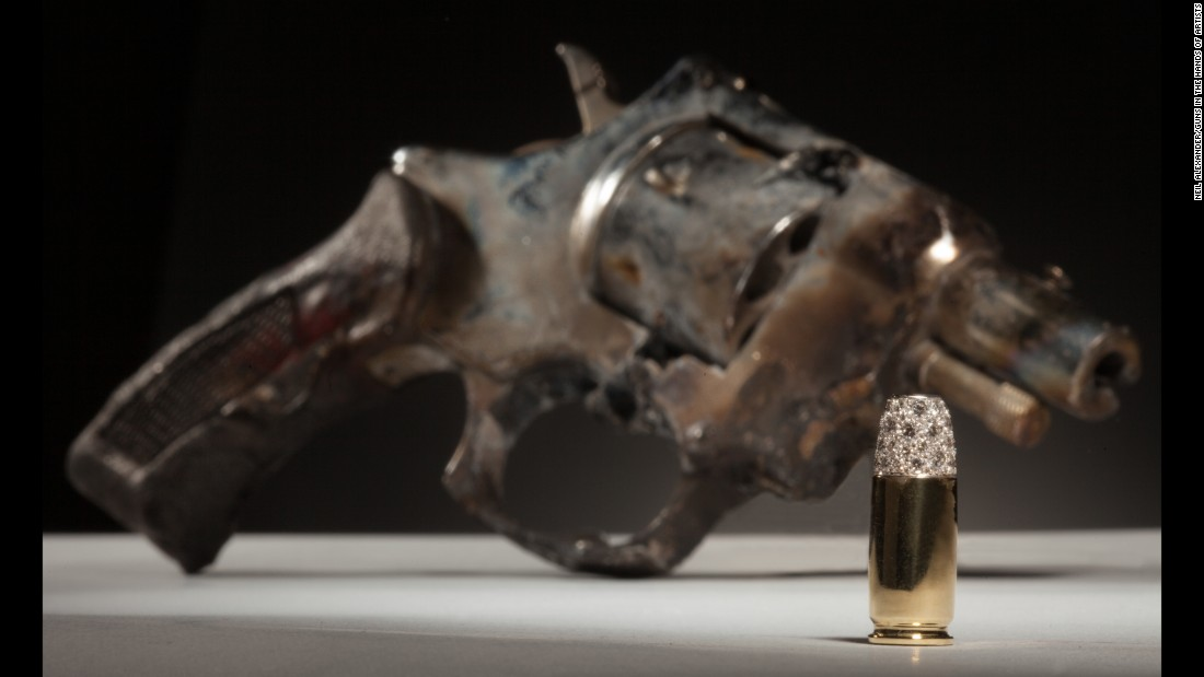 "Nicholas Varney made ""Onegin"" with a gun and created a bullet out of 18-karat gold and diamonds. ""Hopefully,"" Varney said, ""the brightness of the bullet sheds light on the gun and all of its significance within New Orleans, a city known for its singular splendor and its foil. It is a gem, after all."""
