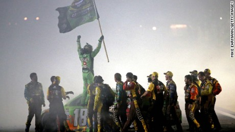 Kyle Busch celebrates with his crew after winning the series championship at Homestead-Miami Speedway on November 22, 2015.