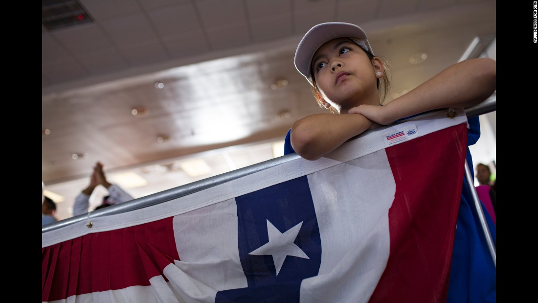 A young girl attends a Clinton rally in Las Vegas on Wednesday, November 2.