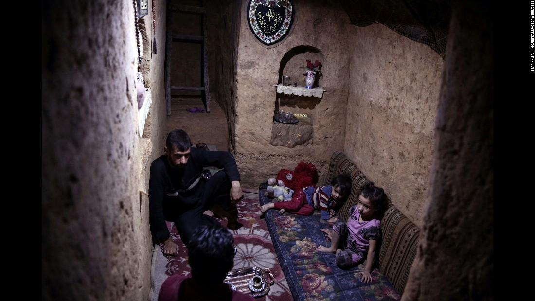 A family sits inside an underground shelter in the war-torn town of Douma, Syria, on Sunday, October 30.