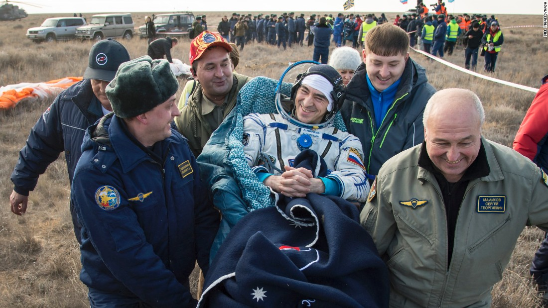 Russian cosmonaut Anatoly Ivanishin is carried into a medical tent in Zhezkazgan, Kazakhstan, after he and two others returned from the International Space Station on Sunday, October 30.