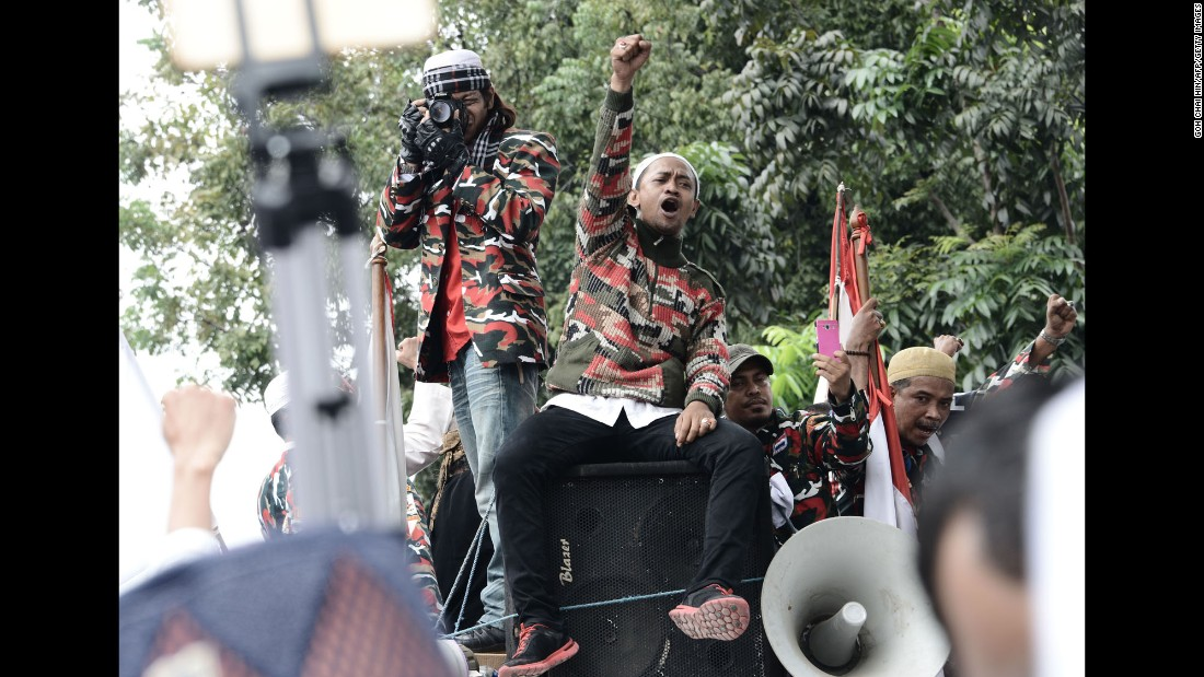 Protesters sat atop a speaker system during the demonstration on November 4.