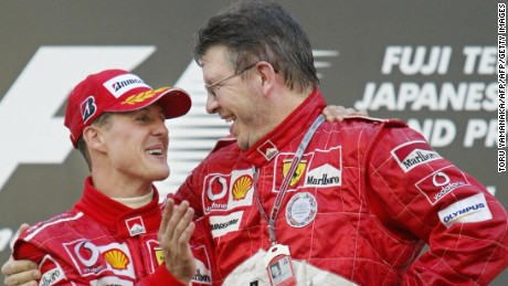 SUZUKA, JAPAN:  World champion Michael Schumacher (L) of Germany is congratulated by the team's technical director Ross Brawn (R) during an awarding ceremony in the Formula One Japanese Grand Prix at Suzuka Circuit in Suzuka, central Japan, 10 October 2004. Schumacher won the 53-lap race with a time of 1 hour 24 minutes and 26.985 seconds.          AFP PHOTO/Toru YAMANAKA  (Photo credit should read TORU YAMANAKA/AFP/Getty Images)