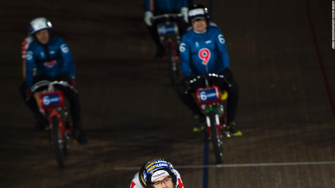 Riders, including Huybrechts (no 6), take part in a Derny race during the Six Day London event.