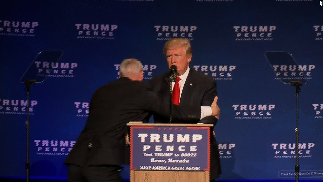 Trump rushed off stage at campaign rally; protester says he was roughed up