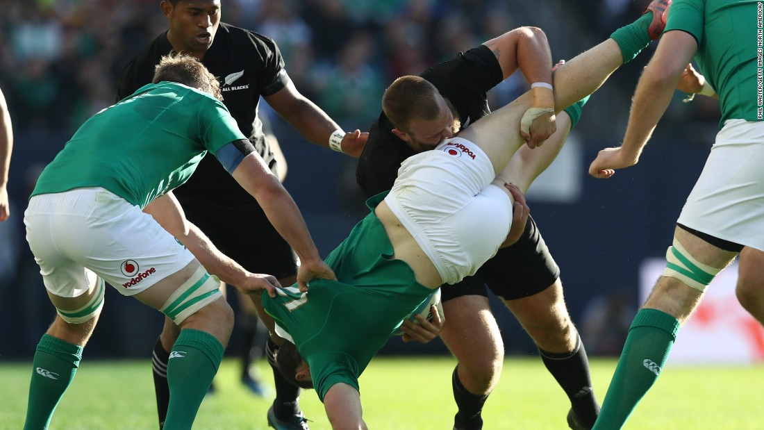 Robbie Henshaw of Ireland is upended by Joe Moody of New Zealand during the international match between Ireland and New Zealand at Soldier Field.