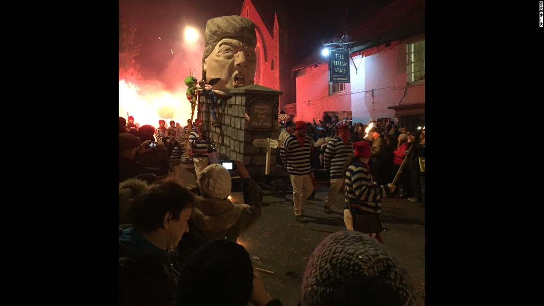 "This effigy portrays the Republican presidential nominee as ""Humpy Trumpty"" sitting on his wall. Trump's proposal for a wall between Mexico and the United States has been a centerpiece of his campaign."