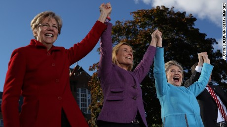 U.S. Sen Elizabeth Warren, New Hampshire Gov. Maggie Hassan and Hillary Clinton get in formation at an October campaign rally.