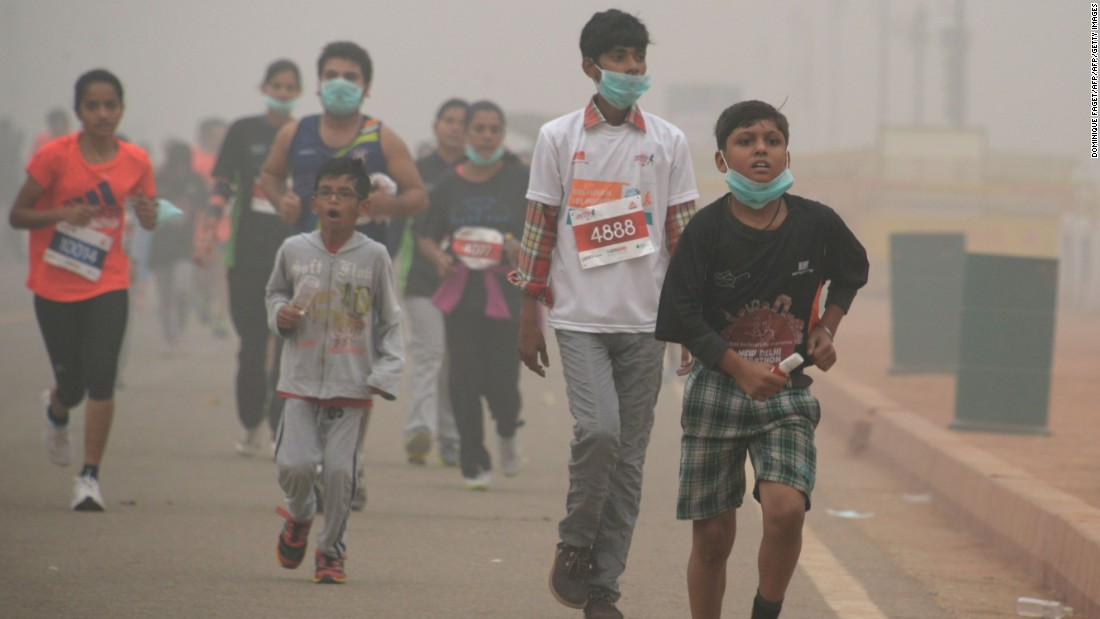 Young Indian runners take part in the New Delhi 10K Challenge amid heavy smog on November 6.