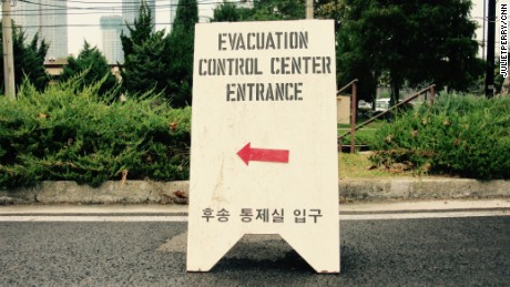 A sign directs evacuees at Yongsan Garrison army base in Seoul.