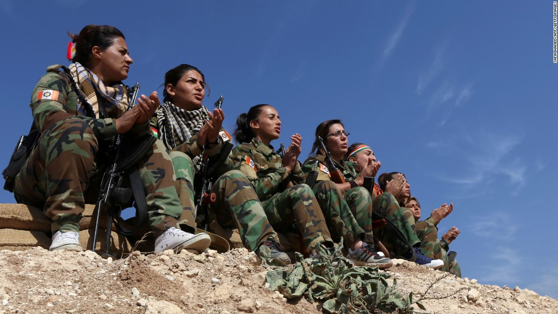 Female members of the Freedom Party of Kurdistan sing as they hold a position near Bashiqa on November 6.
