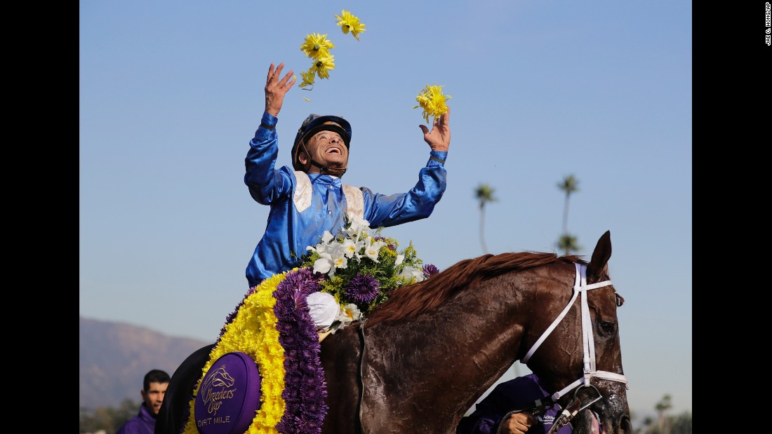 Jockey Mike Smith celebrates Friday, November 4, after he rode Tamarkuz to victory in the Breeders' Cup Dirt Mile race in Arcadia, California.