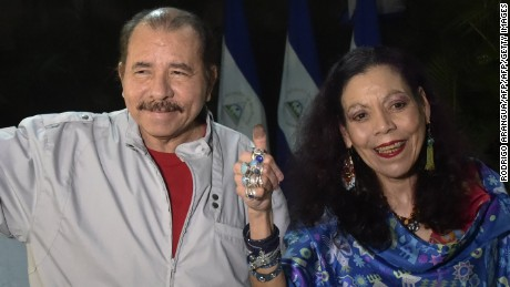 Nicaraguan President Daniel Ortega and his wife Rosario Murillo give thumbs up after voting in Managua during the presidential election on November 6, 2016.  Nicaragua's President Daniel Ortega and his wife, Rosario Murillo, looked likely to win elections that would hand him a third straight term and cement her role as co-ruler. / AFP / RODRIGO ARANGUA        (Photo credit should read RODRIGO ARANGUA/AFP/Getty Images)