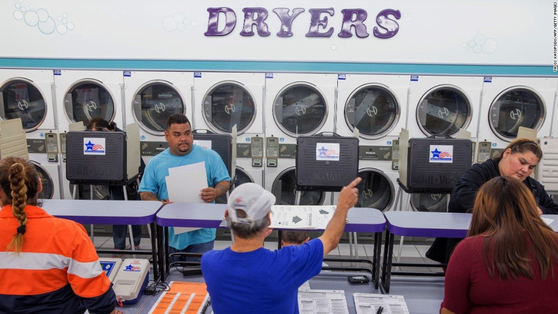 Voters cast their ballots at a Chicago laundromat on November 8.
