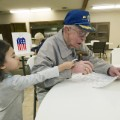WWII vet cheered while voting