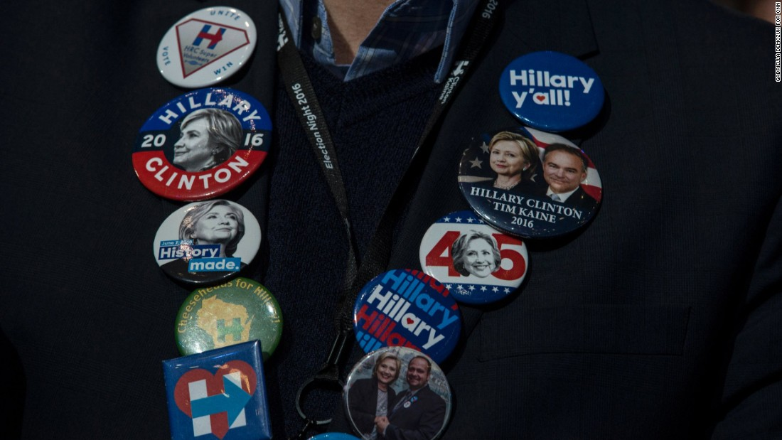 Buttons decorate a Clinton supporter at the Javits Center.