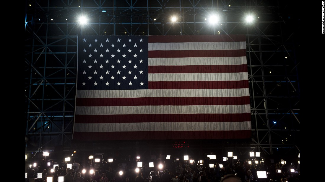 An American flag hangs above the media at the Javits Center.