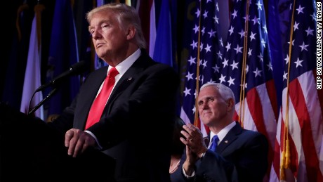 Republican president-elect Donald Trump delivers his acceptance speech as Vice president-elect Mike Pence looks on in the early morning hours of November 9, 2016.