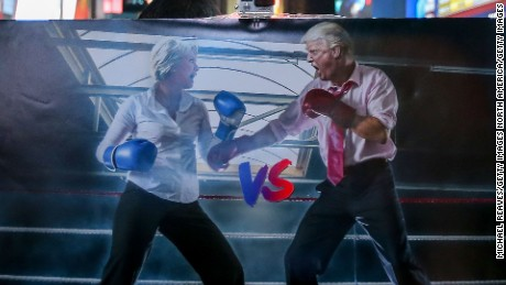 NEW YORK, NY - NOVEMBER 08:  A graphic depicting Hillary Clinton and Donald Trump squaring off in a boxing ring sits in Times Square on November 8, 2016 in New York City. Trump was leading the delegate count and popular vote late election night.  (Photo by Michael Reaves/Getty Images)