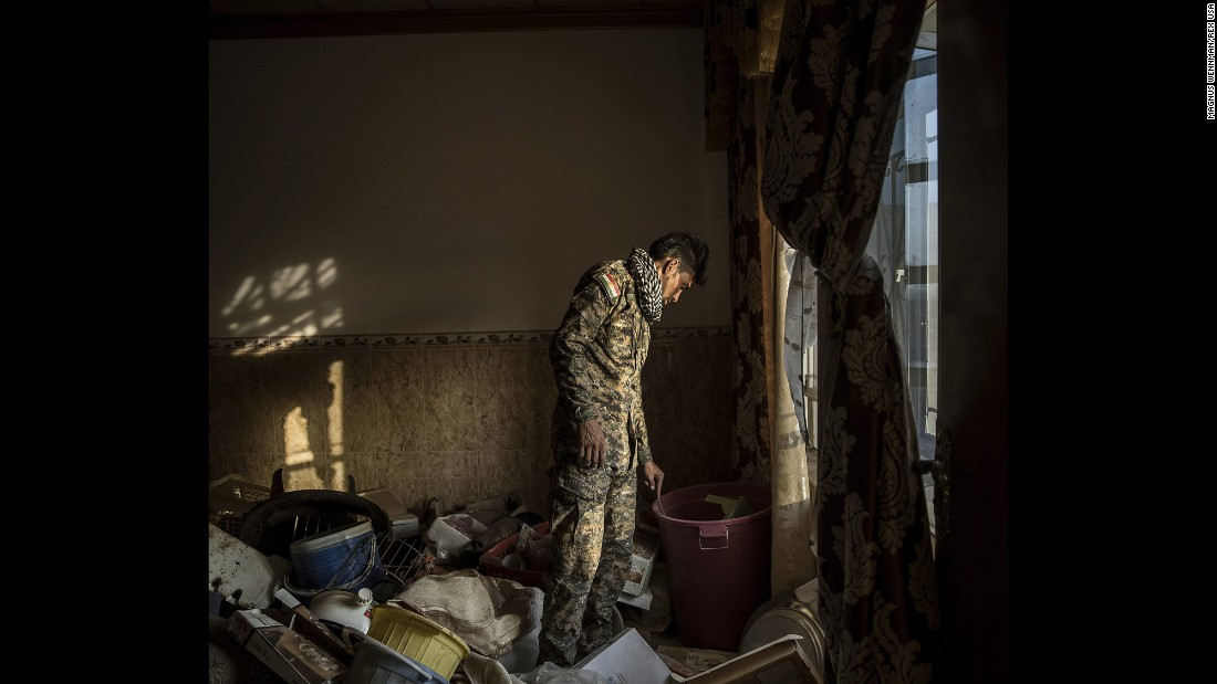 Kurdish Peshmerga forces inspect an abandoned house on the outskirts of Mosul, Iraq, in October. Kurdish forces are part of the Iraqi-led coalition to reclaim Mosul, Iraq's second-largest city, from the ISIS militant group.