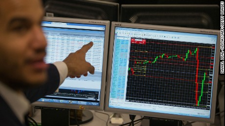 A trader points to a the trading terminal screen showing the S&P 500 Index, as he works at ETX Capital in central London on November 9, 2016, following the result of the US presidential election. Global stock markets sank Wednesday after Republican maverick Donald Trump won the US presidency, fanning fears over the world economy, but London attempted a brief rebound in exceptionally volatile trade. / AFP PHOTO / DANIEL LEAL-OLIVASDANIEL LEAL-OLIVAS/AFP/Getty Images
