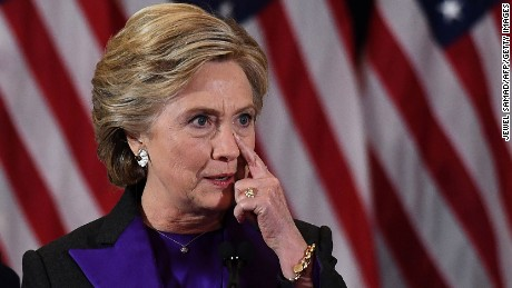 Hillary Clinton pauses as she makes a concession speech after being defeated by Republican President-elect Donald Trump, in New York on November 9, 2016.