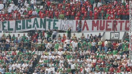 "Mexico fans with a banner reading ""the giant is not dead"" during a 2005 World Cup qualifier."