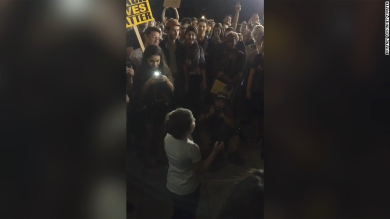 Young girl inspires protesters to chant with her
