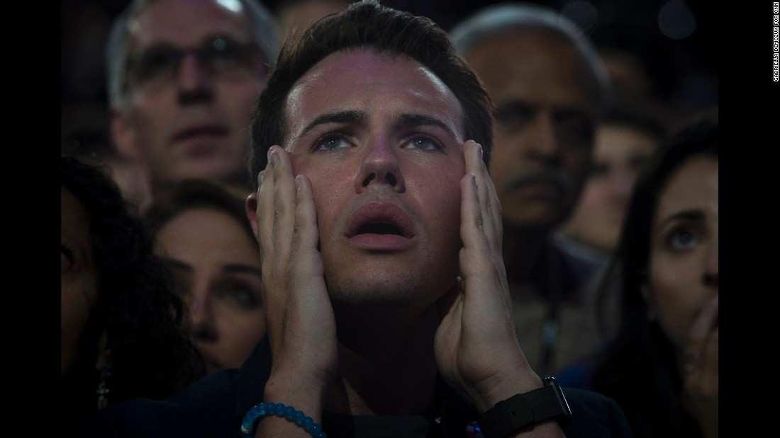 "<strong>November 8:</strong> A man reacts as he watches voting results at the Javits Center in New York City. Supporters of Hillary Clinton had their hopes shattered after Republican nominee Donald Trump<a href=""http://www.cnn.com/2016/11/08/politics/election-day-2016-highlights/index.html"" target=""_blank""> was elected the 45th President of the United States.</a>"