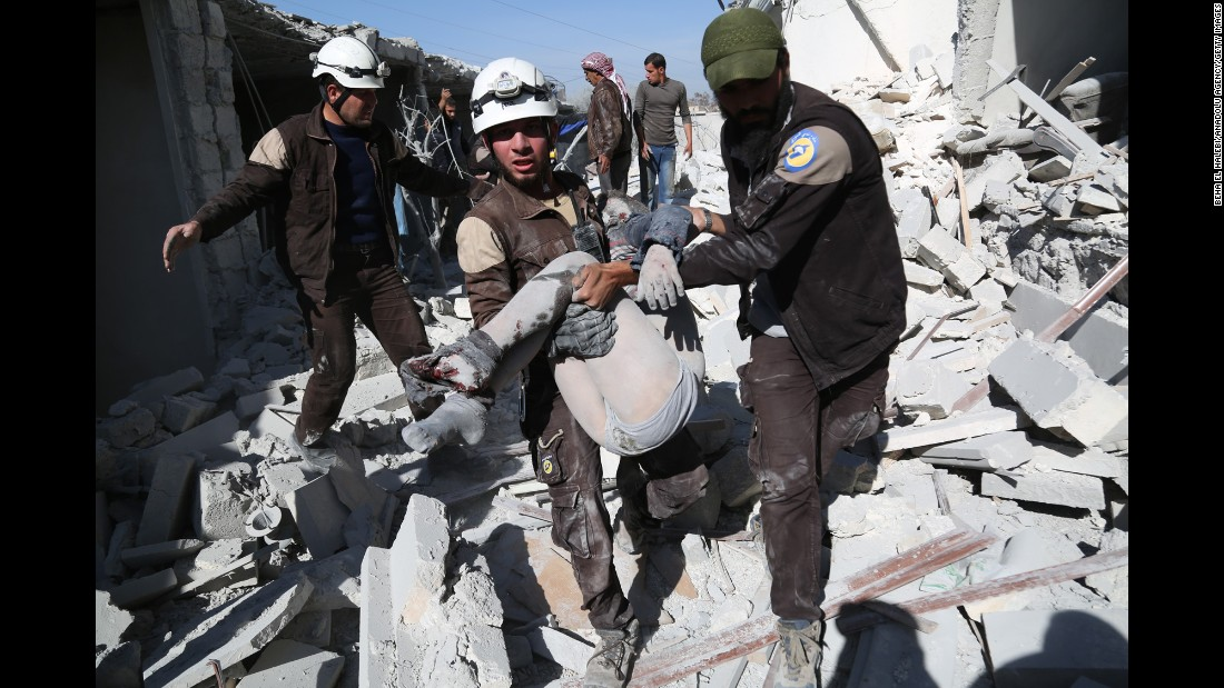 "Members of the Syrian Civil Defense, also known as the White Helmets, carry a person who was wounded after airstrikes in Aleppo, Syria, on Saturday, November 5. Since the civil war began in 2011, an estimated <a href=""http://www.unmultimedia.org/radio/english/2016/04/syria-envoy-claims-400000-have-died-in-syria-conflict/#.WCT7ARorIQ-"" target=""_blank"">400,000 Syrians have been killed</a>, according to the United Nations."