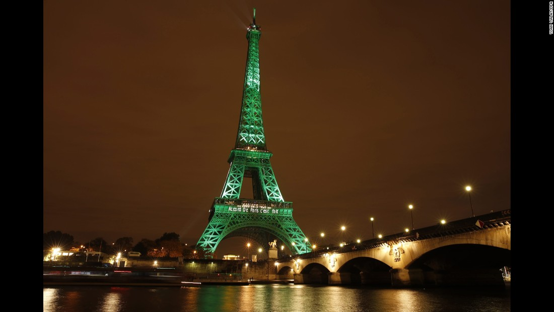 "The Eiffel Tower is illuminated to celebrate the ratification of the COP21 climate change agreement in Paris on Friday, November 4. The agreement, <a href=""http://www.cnn.com/2015/12/14/opinions/sutter-cop21-climate-5-things/"" target=""_blank"">adopted by 195 countries in October</a>,  aims to reduce the world's fossil fuel emissions as well as keep the world's temperature increase ""well below"" 2 degrees Celsius."