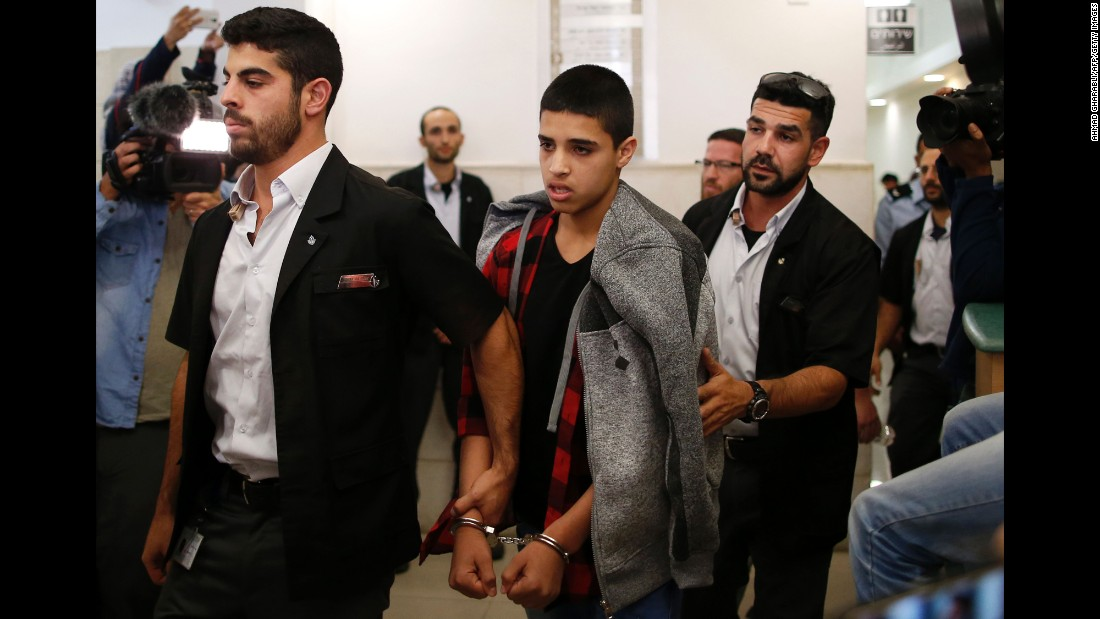 "Ahmed Manasra, center, leaves a court in Jerusalem on Monday, November 7. The 14-year-old Palestinian boy was sentenced to 12 years in prison for carrying out a stabbing attack that wounded two Israelis in October last year, <a href=""http://www.reuters.com/article/us-israel-palestinians-sentence-idUSKBN1321XK?il=0"" target=""_blank"">according to Reuters</a>."