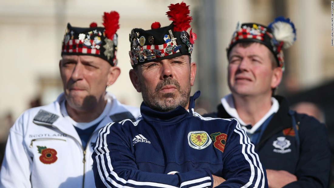 Scotland football fans stand in London's Trafalgar Square as they wait to observe two minutes of silence in honor of Armistice Day on November 11.