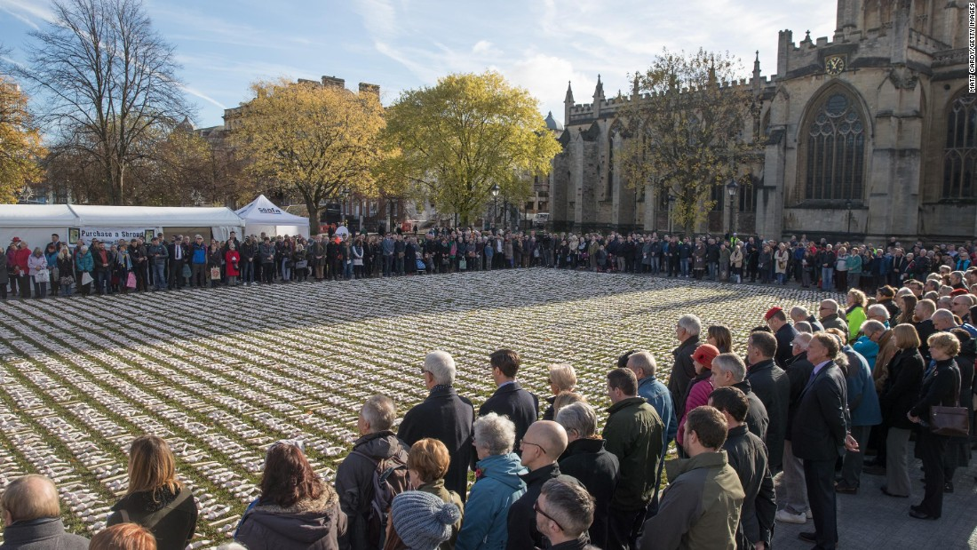 People gather around 19,420 figurines that were laid out in Bristol, England, as part of Rob Heard's Shrouds of the Somme art installation on November 11. A memorial service was held beside the artwork, which features one figurine for every British soldier who died on the first day of World War I's Battle of the Somme.