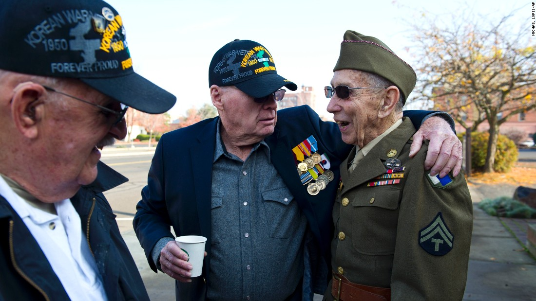Korean War veterans Ken Silver, left, and Paul Hellie, center, greet four-time Purple Heart recipient Emil Reynold before a Veterans Day parade in Walla Walla, Washington, on November 11.