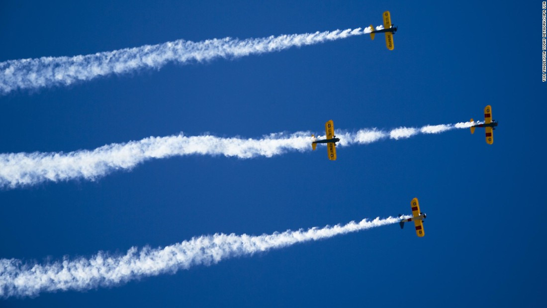 Planes fly over Central Avenue in Phoenix at the start of the Veterans Day Parade on November 11.