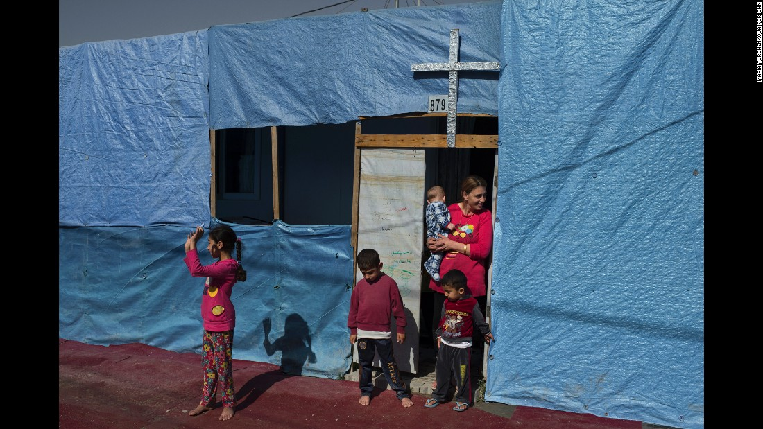 Many families have decorated their temporary homes, made from shipping containers, with crosses, as if to signal their distress and show their resolve for their faith.