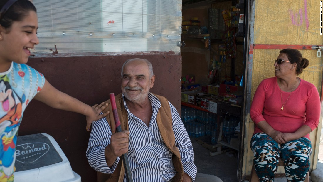 Raja Paulous, 46, right, runs a small grocery at Ashti camp. Back home in Qaraqosh, she had a grocery service and led a happy life. She can't find it in her heart to forgive ISIS for destroying her life.