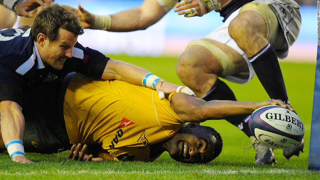 Australia's Tevita Kuridrani reaches out to score the final try against Scotland at Murrayfield.