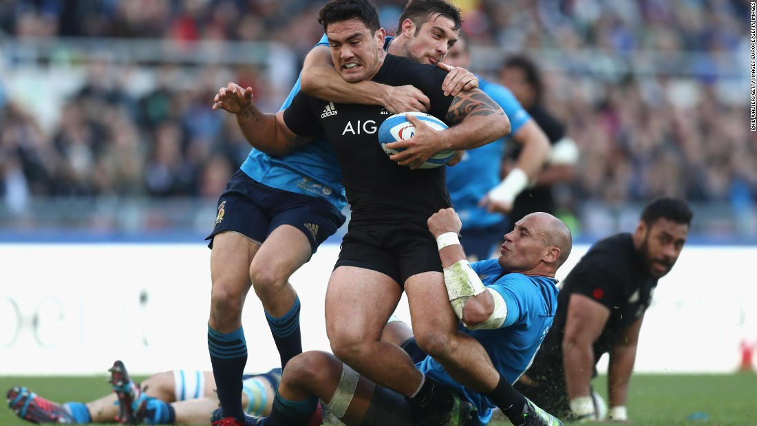 It takes two to bring down Codie Taylor of the New Zealand All Blacks.