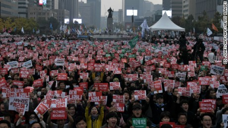 CORRECTION - Demonstrators hold placards calling for the resignation of South Korean President Park Geun-Hye in Gwanghwamun square in central Seoul on November 5, 2016. Thousands of South Koreans took to the streets November 5 to demand embattled President Park Geun-Hye resign over a crippling corruption scandal.  / AFP / Ed JONES / The erroneous mention[s] appearing in the metadata of this photo by Ed JONES has been modified in AFP systems in the following manner: [Park Geun-Hye] instead of [Park Guen-Hye]. Please immediately remove the erroneous mention[s] from all your online services and delete it (them) from your servers. If you have been authorized by AFP to distribute it (them) to third parties, please ensure that the same actions are carried out by them. Failure to promptly comply with these instructions will entail liability on your part for any continued or post notification usage. Therefore we thank you very much for all your attention and prompt action. We are sorry for the inconvenience this notification may cause and remain at your disposal for any further information you may require.        (Photo credit should read ED JONES/AFP/Getty Images)