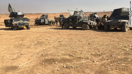 Armored Humvees from the Kirkuk regiment retreat after facing fierce resistance from ISIS.