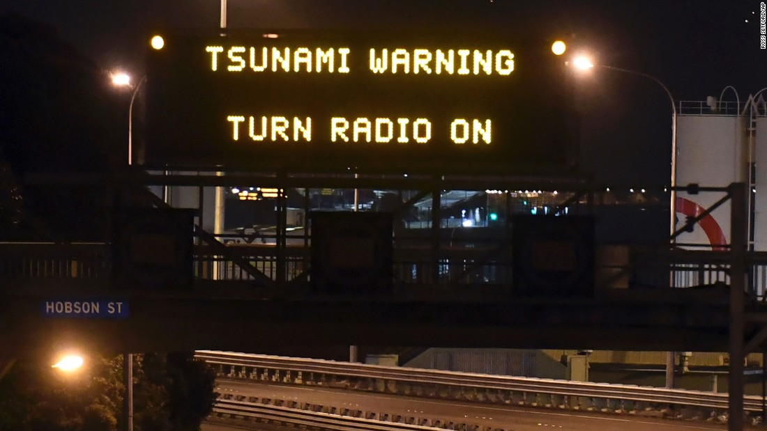 A road sign flashes a tsunami warning in Wellington on November 14. Waves of just over two meters high hit the coast following the earthquake.