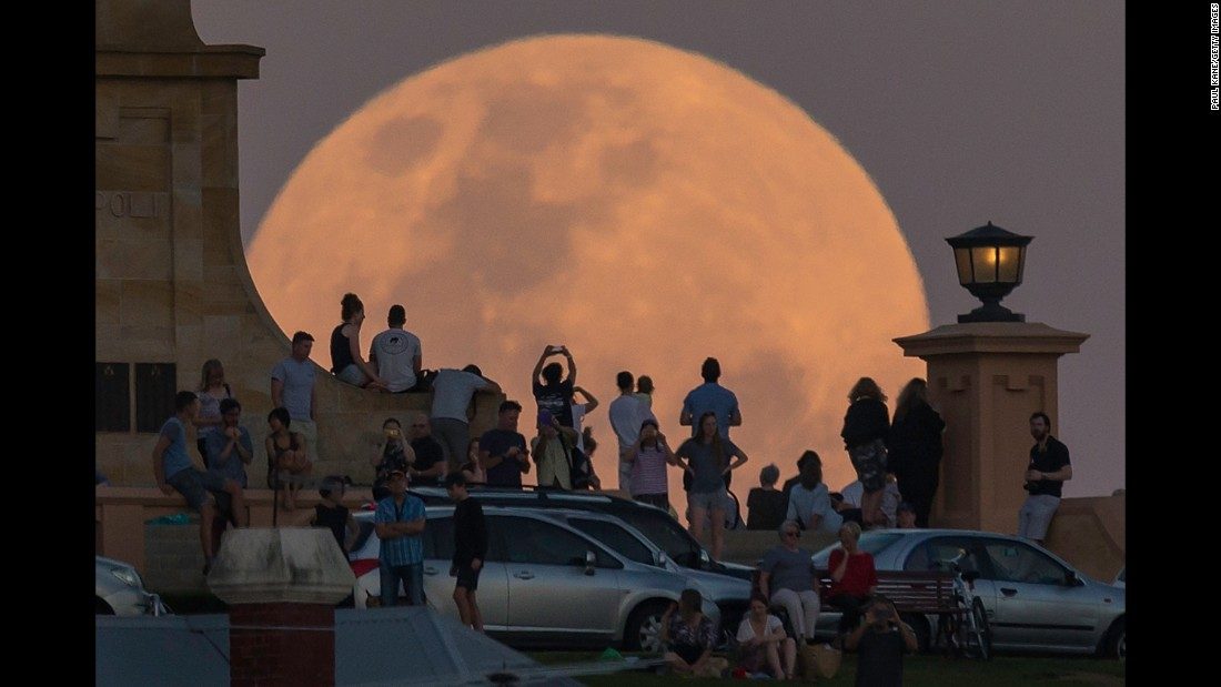 "Crowds in Fremantle, Australia, look at <a href=""http://www.cnn.com/2016/11/14/world/supermoon-november-2016/"" target=""_blank"">the supermoon</a> on Monday, November 14. NASA scientists say the moon is brighter than it has appeared at any point in the last 68 years."