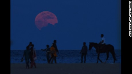 A supermoon rises at Marina Beach in Chennai, India, on November 14, 2016.